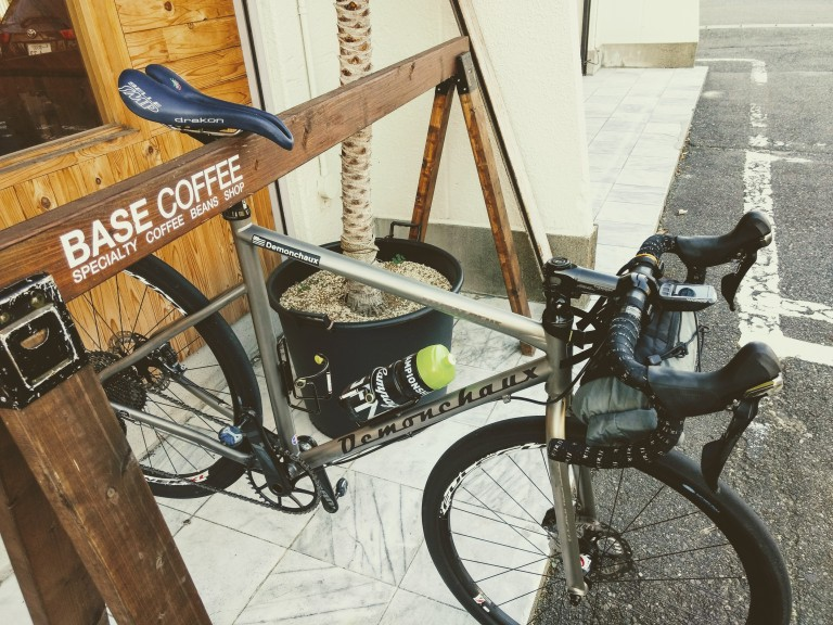DMCX Titanium bicycle hanging front of coffee shop